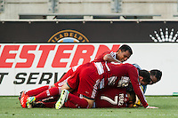 Blas Perez (7) of FC Dallas celebrates scoring with teammates. The Philadelphia Union and FC Dallas played to a 2-2 tie during a Major League Soccer (MLS) match at PPL Park in Chester, PA, on June 29, 2013.