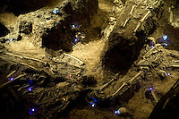 "Visitors can see the remains of Nanjing Massacre victims at the ""Mass Grave of 10,000 Corpses"" in the Memorial Hall of the Nanjing Massacre now sits in Nanjing, China, on Thursday, Dec. 13, 2007. After two years of renovations, the Memorial Hall of the Nanjing Massacre reopened to the public on Dec. 13, 2007, the 70th anniversary of the 6-week massacre by Japanese troops that started Dec. 13, 1937 and claimed more than 300,000 lives.  The commemoration comes amid renewed controversy about the accuracy of historical accounts of the massacre.  The massacre is also known as ""The Rape of Nanking."""