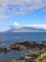 Standup paddleboarders in the waters off of Wailea Beach, South Maui.