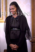 first lady Michelle Obama , Benedict XVI, during a meeting with U.S. President Barack Obama greets Pope in the pontiff's private library at the Vatican .July 10, 2009.