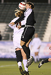 Wake Forest's Kaley Fountain (r) and Florida State's Kirsten van de Ven (l) challenge for a header on Friday, November 3rd, 2006 at SAS Stadium in Cary, North Carolina. The Florida State University Seminoles defeated the Wake Forest University Demon Deacons 4-2 on penalty kicks after their Atlantic Coast Conference Women's Soccer Championship semifinal game ended in a 0-0 overtime tie.