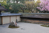 Trees surround the outer walls of the Ryoan-ji Temple garden and provide a contrast to the minimal, and most famous, karesansui (dry landscape) garden