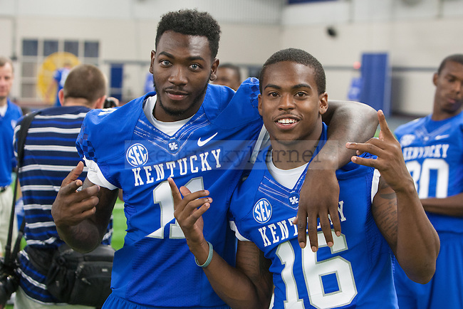 Cornerbacks J.D. Harmon and Cody Quinn pose during UK football media day at Nutter Field House in Lexington, Ky., on Friday, August 8, 2014. Photo by Adam Pennavaria | Staff