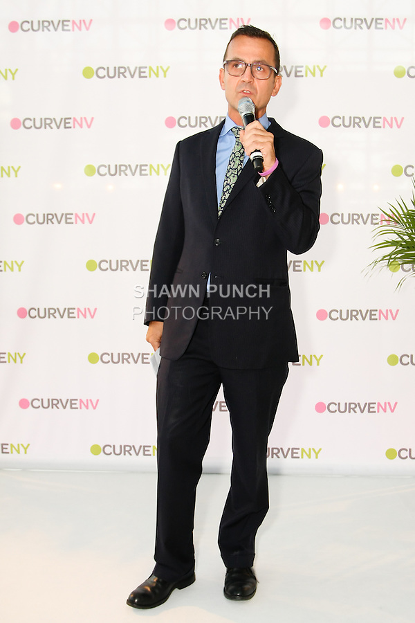 Steven Kolb speaks to audience at the CURVE and CFDA Party For A Cause event during the CURVENY Lingerie & Swim show, at the Jacob Javits Convention Center, August 2, 2010.