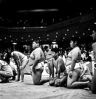 Young Rikishi Sumo competitors wait beside the Dohyo before their contest..450 children, aged between 11-14, qualified for  the All Japan Wanpaku Sumo Tournament. The  Ryogoku Kokugikan Stadium, Tokyo, Japan.
