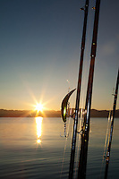 """Fishing Lure at Sunrise"" - This fishing lure and rods were photographed at sunrise on Lake Tahoe."