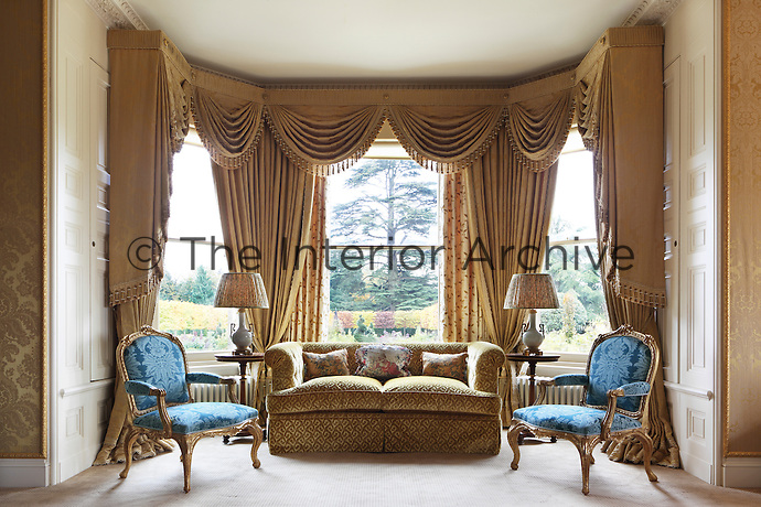 A pair of chairs by John Vardy (1718-65) from Spencer house have been re-upholstered in French silk velvet