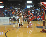Ole Miss guard Chris Warren (12) is defended by Georgia's Dustin Ware (3) at the C.M. &quot;Tad&quot; Smith Coliseum in Oxford, Miss. on Saturday, January 15, 2011. Georgia won 98-76.  (AP Photo/Oxford Eagle, Bruce Newman)