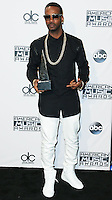 LOS ANGELES, CA, USA - NOVEMBER 23: Juicy J poses in the press room at the 2014 American Music Awards held at Nokia Theatre L.A. Live on November 23, 2014 in Los Angeles, California, United States. (Photo by Xavier Collin/Celebrity Monitor)