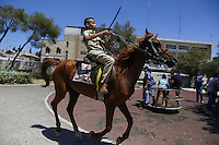 Palestinian kid enjoy horse riding at a park during Eid al-Fitr, which marks the end of the holy month of Ramadan on August 09, 2012 in Jerusalem, Israel. Israel is expected to allow the entry of hundreds of thousands of Palestinians from the occupied West Bank to celebrate Eid al-Fitr due to improved security. Photo by Oren Nahshon