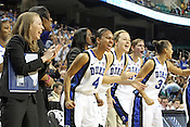 The Duke bench celebrates a layup from Jasmine Thomas. This was the Championship game of the 2011 ACC Tournament in Greebsboro on March 6, 2011. Duke beat UNC 81-66. (Photo by Al Drago)