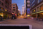 Night falls on a bustling street in downtown Seattle. this image is available through an alternate architectural stock image agency, Collinstock located here: http://www.collinstock.com