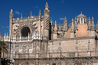 General view showing the Sacristia Mayor dome and the upper part of the Puerta de San Cristobal or del Principe, Seville Cathedral, Andalucia, Spain, pictured on December 27, 2006 in the wintry midday sun. Seville Cathedral is the largest Gothic building in the world. It was converted from the original 12th century Almohad Mosque on this site during the 16th century and the original Moorish entrance court and Giralda Minaret are both integrated in the cathedral. Inside is the tomb of the explorer Christopher Columbus (1451-1506). The Sacristia Mayor dome was rebuilt after an earthequake in 1888. Picture by Manuel Cohen