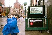 "A sign informs travelers of the shutdown of the New York City subway system in the Chelsea neighborhood of New York on Monday, October 29, 2012. Hurricane Sandy continues its steady advance with heavy wind and rain. New York has shut down the schools, the transit system and the Holland and Hugh L. Carey Tunnels have been closed. Evacuations have been ordered in the ""Zone A"" areas including Battery park City. (© Richard B. Levine)"