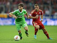 FUSSBALL   1. BUNDESLIGA  SAISON 2012/2013   5. Spieltag FC Bayern Muenchen - VFL Wolfsburg    25.09.2012 Xherdan Shaqiri (re, FC Bayern Muenchen) gegen Diego (VfL Wolfsburg)