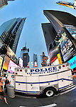 Times Square with Police Emergency Service Truck parked shortly after police re-opened area to people and traffic, Manhattan, NYC, NY, USA on June 27, 2011. NOTE: a fisheye view, motion blur of woman entering scene at extreme left  (EDITORIAL USE ONLY)
