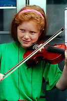 Irish girl playing violin on Grafton Street, Dublin, Ireland