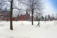 Cross Country Skiing on the UVM Campus Green in front of Williams and Old Mill.  Winter UVM Campus