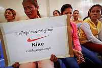 """Som Cheantha, a eight month pregnant garment worker cries and holds a sign during a gathering of workers at their union headquarters in Phnom Penh June 27, 2013. Som Cheantha cried for her husband, also a garment worker, who she said was arrested following a protest that turned violent at Sabrina (Cambodia) Garment Manufacturing Corp factory that produces clothing for U.S. sportswear company Nike. The sign reads """"We, all together, support Nike to put orders in Cambodia"""". The garments industry has become by far Cambodia's biggest export earner, with shipments up 10 percent in 2012 to $4.44 billion. As investment in Cambodia's textile industry surges, so is labor unrest, putting pressure on suppliers to the world's big garment brands to raise wages and improve sometimes grim conditions in one of the last bastions of low-cost factories.   REUTERS/Damir Sagolj (CAMBODIA)"""