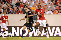Jordan Harvey (2) of the Philadelphia Union and Danny Welbeck (19) of Manchester United race fora ball played into space during an international friendly between Manchester United (EPL) and the Philadelphia Union (MLS) at Lincoln Financial Field in Philadelphia, PA, on July 21, 2010.