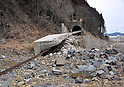 March 8, 2012, Minamisannriku-cho, Japan - A huge concrete slab remains over the local railroad track at Minamisannriku-cho, Miyagi Prefecture, some 365 km northeast of Tokyo, on Thursday, March 8, 2012. ..One year after the strongest earthquake ever to hit Japan, the economy is recovering and massive cleanup operations are in full swing throughout much of the countrys northeastern region. But once-pastoral landscapes that were piled with rubble and debris have become empty wastelands due mainly to bickering and disagreements between the central and local governments over rebuilding the devastated region. A year later, more than 260,000 people still live in temporary shelters. (Photo by Natsuki Sakai/AFLO) AYF -mis-.
