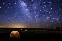 We capture this night skies landscape with a shooting star as it crossed the galaxy as we were taking photos of the milkyway with some hay bales on this Texas landscape in the hill country.  The bales of hay were painted in a gold light in the forground of the image to add the feel of this rural landscape. We loved the effect of all the stars in the sky with the shooting star this night couldn't have turned out better.  Even as far out west in the Texas Hill Country as we were we still can't get away from light pollutions from the nearby towns as seen from the glow at the horizon.  Even so that didn;t deter us as the stars were beautiful.