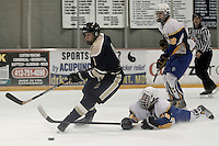 Joseph Demarchi #9 of Norwin skates with the puck past a fallen Zachary Mckown #49 of Canon-McMillan during their quarterfinal game at Southepointe Iceoplex on March 16, 2012 in Canonsburg, PA...(Jared Wickerham/For The Tribune-Review).JW Norwin-CMhockey317.jpg.