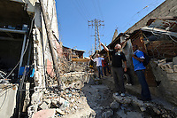 Andy Chaggar and EDV staff near the site a damaged orphanage, Port-au-Prince, Haiti. EDV is committed to affecting permanent change in disaster-affected communities worldwide. Their role is to facilitate personal connections between volunteers and the survivors of disasters.  The charity is based on a proven model developed by several landmark organisations that have paved the way for citizens to become disaster volunteers. These landmark organisations have shown that supposedly ordinary people working together with the guidance of knowledgeable leaders can make an extraordinary difference in the lives of those affected by disaster..EDV believe that to provide meaningful relief and reconstruction assistance to disaster affected communities they have to do more than reconstruct buildings. They need to understand and address the factors that made a community vulnerable to the disaster in the first place. The charity's work is organised with these factors in mind so that they can affect change that far outlives their presence..EDV believes that survivor motivation is essential to the recovery of any disaster-affected community. Their operations will always be predicated on the idea that survivors may be traumatised, but they are not helpless. With this in mind, EDV encourages host communities to direct their own recovery. EDV believe that this empowerment is essential in helping survivors feel a renewed sense of control over their lives which will, in turn, help overcome the feelings of hopelessness that can follow a disaster and inhibit long term recovery. EDV also believe that social cohesion is of primary importance in any disaster-affected area. No amount of bricks or mortar will bring about sustainable improvement if communities fail to come together or are disrupted by relief efforts. Therefore, their operations will always aim to foster communication and cooperation within and between the communities they serve.