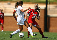 WINSTON-SALEM, NORTH CAROLINA - September 01, 2013:<br />  Erin Yenney (16) of Louisville University pokes the ball away from Katie Stengel (12) of Wake Forest University during a match at the Wake Forest Invitational tournament at Wake Forest University on September 01. The match was abandoned early in the second half due to severe weather with Wake leading 1-0.