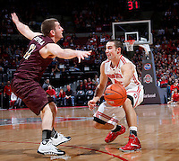 Ohio State Buckeyes guard Aaron Craft (4) is guarded by Louisiana-Monroe Warhawks guard Nick Coppola (11) during Friday's NCAA Division I basketball game at Value City Arena in Columbus on December 27, 2013. Ohio State led the game at halftime, 41-20. (Barbara J. Perenic/The Columbus Dispatch)