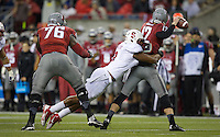 SEATTLE, WA - September 28, 2013: Stanford linebacker James Vaughters hits the Washington State quarterback Connor Halliday during play at CenturyLink Field in Seattle Saturday September 28, 2013. Stanford won 55-17