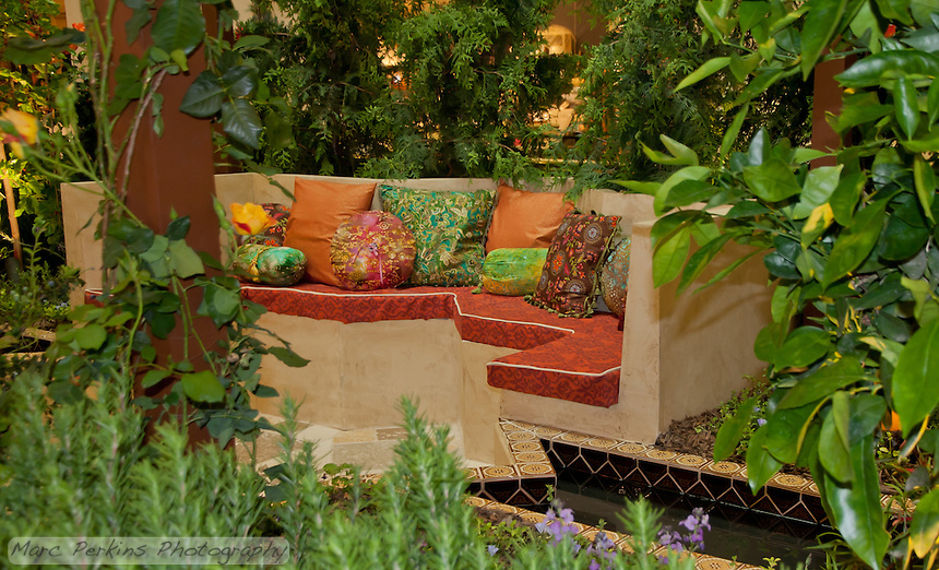 """A garden bench sits amid water features and lush foliage.  The Orange Coast College Hotriculture Club entered the 2011 Spring Garden Show landscape design competition (http://www.springgardenshow.com/) and won first place in the student category for their """"Moorish Flourishes in a Contemporary Garden"""" design."""