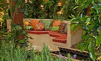 "A garden bench sits amid water features and lush foliage.  The Orange Coast College Hotriculture Club entered the 2011 Spring Garden Show landscape design competition (http://www.springgardenshow.com/) and won first place in the student category for their ""Moorish Flourishes in a Contemporary Garden"" design."