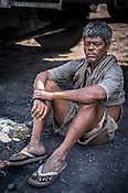 Ramdhani, a daily wage labourer poses for a portrait in Goladi coal depot in Jharia, outside of Dhanbad in Jharkhand, India.  Photo: Sanjit Das/Panos