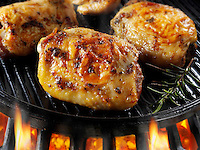 Chicken thighs cooking on a bbq. Food photos, pictures & images.