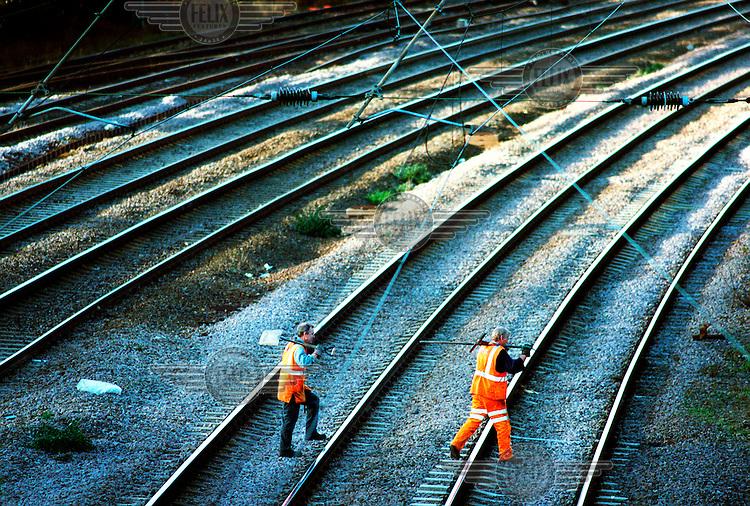 Railtrack contractors work on a railway line near Cricklewood..