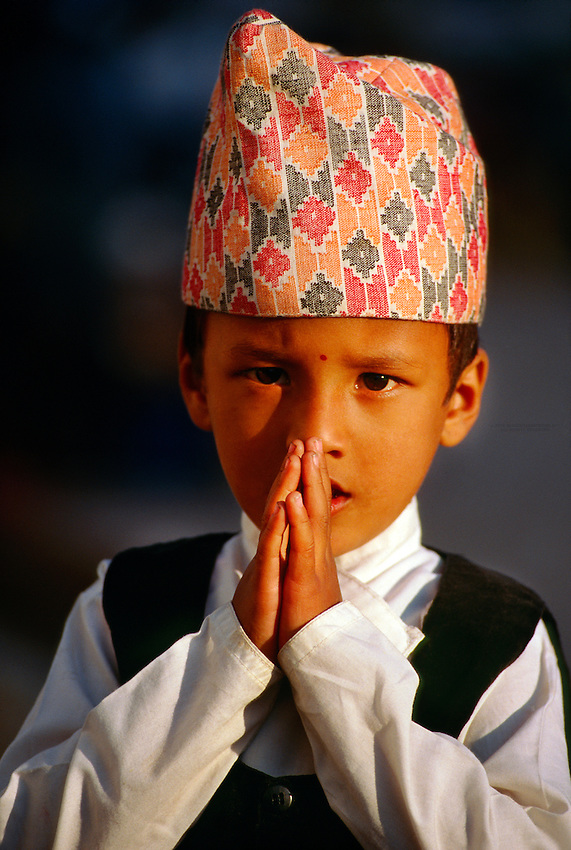 Nepalese boy making   namaste   Namaste Child
