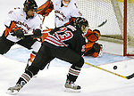 2/6/04 Omaha, NE University of Nebraska at Omaha's Scott Parse fires a shot past Bowling Green University's Steve Brudzewski towards goalie Jordan Sigalet.<br /> <br /> (Chris Machian/Prairie Pixel Group)