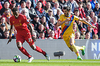 Liverpool's Divock Origi shields the ball from Crystal Palace's James Tomkins<br /> <br /> Photographer Terry Donnelly/CameraSport<br /> <br /> The Premier League - Liverpool v Crystal Palace - Sunday 23rd April 2017 - Anfield - Liverpool<br /> <br /> World Copyright &copy; 2017 CameraSport. All rights reserved. 43 Linden Ave. Countesthorpe. Leicester. England. LE8 5PG - Tel: +44 (0) 116 277 4147 - admin@camerasport.com - www.camerasport.com