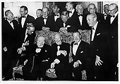 London, GBR - February 9. 1959 -- Twenty-one British war leaders were the guests of United States President Dwight D. Eisenhower at a dinner given at the United States Ambassador's home in London on February 9. 1959.  On the settee (L-R) Sir Winston Churchill; President Eisenhower; and Earl Alexander.  Grouped around them are some of the other guests - on the arms of the settee Lord Alanbrooke left and Mr. Macmillan, standing from left Lord Montgomery, U.S. Ambassador Whitney, Brigadier Lionel Cross, Lord Portal, Sir Kenneth Strong, Lord Tedder, Sir Roger Makins, Sir Brian Horrocks, Lord Ismay, Sir Arthur Morris..Credit: Pool / CNP