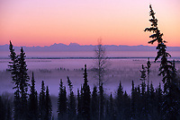 Alaska mountain range horizon, Mt. Deborah, Hess, viewed looking south over ice fog and Tanana Valley flats, Fairbanks, Alaska