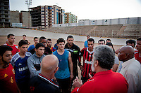 On visit to the club of their friend Mahmoud Abouchkeiwa, Hadi Jamhour, 78 years, and Aboubakar Frah, 82 years, share their experience in front of a flowerbed of young stunned sportsmen.