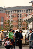 New workers wait to be accepted for work. 50% of new workers quit after one days work due to the terrible conditions. In the background, the dorm rooms are kept under 24 hour camera survielence. In the south of China, Apple Macintosh sub-contracts Chinese companies; Asus and Foxconn to make its popular Ipod products. Workers pay and conditions are very questionable. In relation to Ipod's western market prices the workers do not recieve fair salaries and conditions.