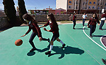 Students play basketball in the Lydia Paterson Institute in El Paso, Texas. Most of the school's students travel across the border every day from their homes in Juarez, Mexico, to study at the United Methodist-sponsored high school.
