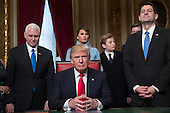 United States President Donald Trump is joined by the Congressional leadership and his family before formally signing his cabinet nominations into law, Friday, Jan. 20, 2107, in the President's Room of the Senate on Capitol Hill in Washington. From left are, US Vice President Mike Pence, the president's wife Melania Trump, their son Barron Trump, and Speaker of the US House Paul Ryan (Republican of Wisconsin).<br /> Credit: J. Scott Applewhite / Pool via CNP