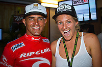 Newly crowned World Champions Kelly Slater (USA) and Stephanie Gilmore (AUS).   SOMEWHERE, Porta Del Sol/Puerto Rico (Saturday, November 6, 2010) -Kelly Slater (USA), 38, has made sporting history today, claiming an unprecedented 10th ASP World Title at Rip Curl Pro Search Puerto Rico.. .With his advancement out of the Quarterfinals of the Rip Curl Pro Search Puerto Rico over Adriano de Souza (BRA), 23, Slater amassed enough points to move out of reach remaining contender Jordy Smith (ZAF), 22, and collect the 2010 ASP World Title, culminating a 20-year effort..Kelly Slater (USA), 38, newly-crowned 10-time ASP World Champion, has claimed his 45th elite tour event, taking down the Rip Curl Pro Search Puerto Rico over Bede Durbidge (AUS), 27, in pumping three-to-four foot (1.5 metre) waves in Porta Del Sol.. .Event No. 9 of 10 on the 2010 ASP World Tour, the Rip Curl Pro Search Puerto Rico has been an event of extremes.. .Last Tuesday, the international sporting world was dealt a devastating blow with the tragic and unexpected loss of former three-time ASP World Champion and current ASP World Tour competitor Andy Irons (HAW), 32.. .After a somber two-day postponement of the event out of respect for Irons's passing, the world's best surfers roared back to life for two of the most high-performance days in surfing history.. .Today, Slater clinched his historic and unprecedented 10th ASP World Title before going on to take out the Rip Curl Pro Search Puerto Rico, as comprehensive and dominant a performance as the sporting world has ever bore witness to..Photo: joliphotos.com