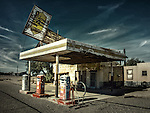 Abandoned service station in America with old petreol pumps