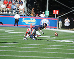 Ole Miss wide receiver Jesse Grandy (10) fumbles against Jacksonville State defensive back T.J. Heath (15)  at Vaught-Hemingway Stadium in Oxford, Miss. on Saturday, September 4, 2010. (AP Photo/Oxford Eagle, Bruce Newman)
