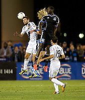 Tommy Meyer of Galaxy battles for the ball in the air against Earthquakes' Steven Lenhart and Ike Opara during the game at Buck Shaw Stadium in Santa Clara, California on November 7th, 2012.   LA Galaxy defeated San Jose Earthquakes, 3-1.