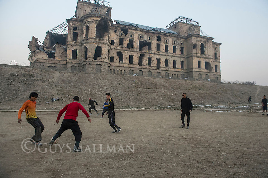 Afghan boys playing football near the Darulaman Palace in Kabul. 2-1-14